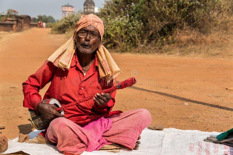 Baul folk singer. BISHNUPUR, INDIA - DECEMBER 20: A Baul - Indian folk singer performs in front of Jorbangla temple on December 20, 2014 in Bishnupur, West royalty free stock photos