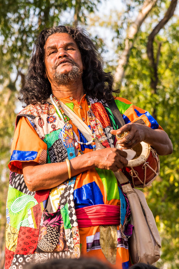 Baul folk singer in India. SHANTINIKETAN, INDIA - DECEMBER 26: An Indian traditional baul singer performs during the annual Poush Mela fair on December 26, 2015 royalty free stock images