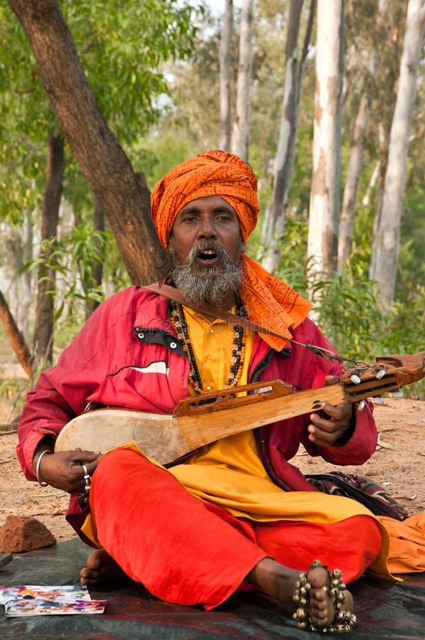 Baul folk singer performing. SHANTINIKETAN, INDIA - DECEMBER 22: Traditional baul folk singer performs during the annual Poush Mela fair on December 22, 2012 in stock photography