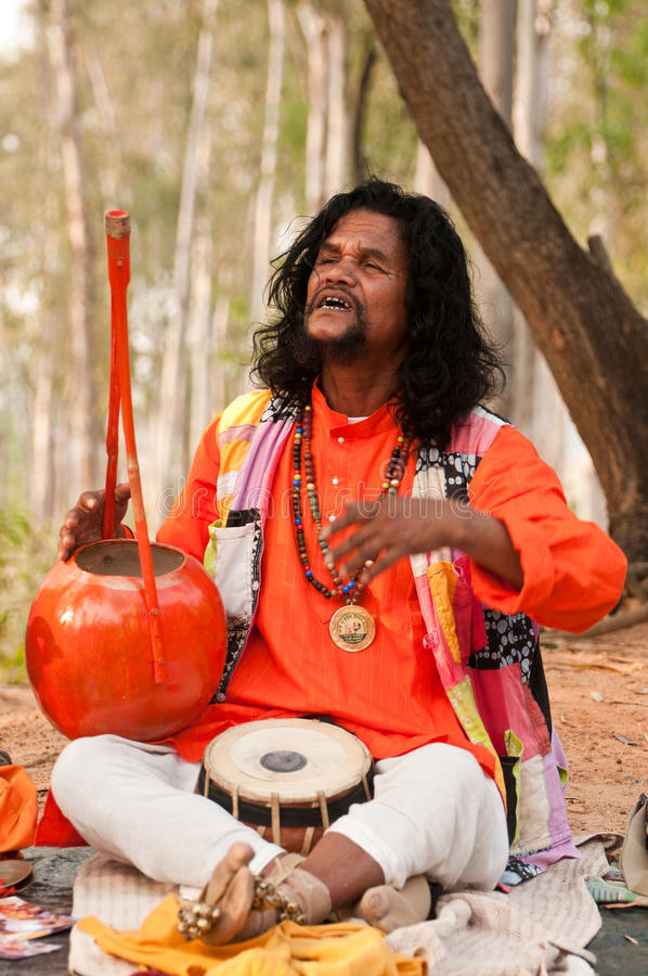 Baul folk singer performing. SHANTINIKETAN, INDIA - DECEMBER 22: An unidentified baul folk singer performs during the annual Poush Mela fair on December 22, 2012 stock images