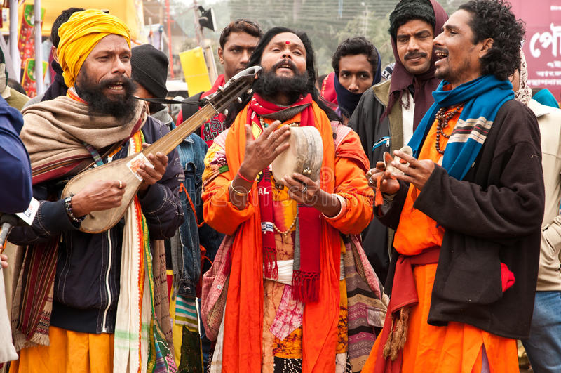 Baul performance in Poush Mela. SHANTINIKETAN, INDIA - DECEMBER 25: Traditional baul folk singers perform during the annual Poush Mela fair on December 25, 2012 royalty free stock photos