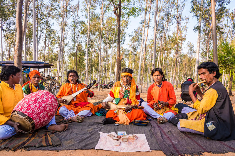 Baul singers perform at Shantiniketan. SHANTINIKETAN, INDIA - DECEMBER 26: An Indian traditional baul folk band performs during the annual Poush Mela fair on royalty free stock images