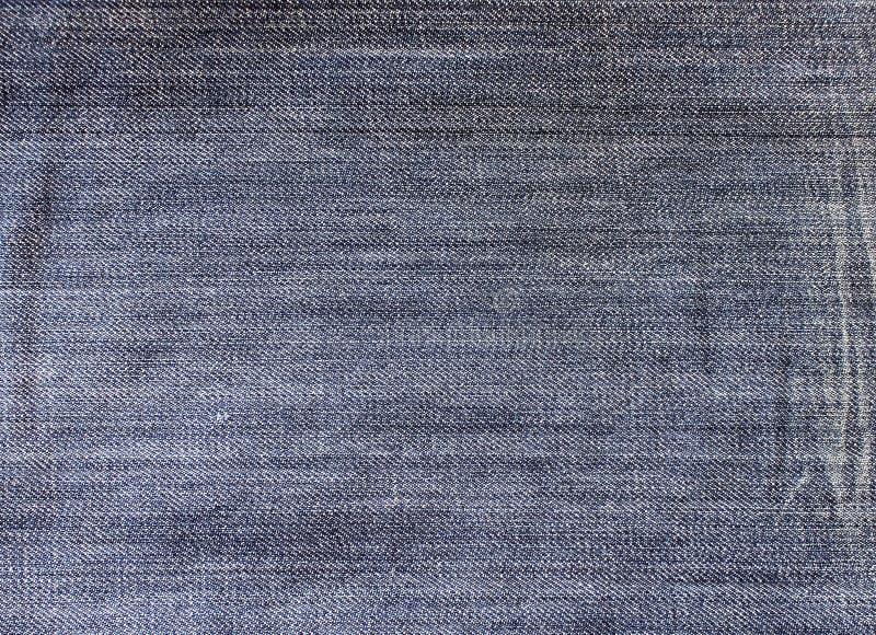 Baumwollgewebe eines Jeansdetails stockfotos
