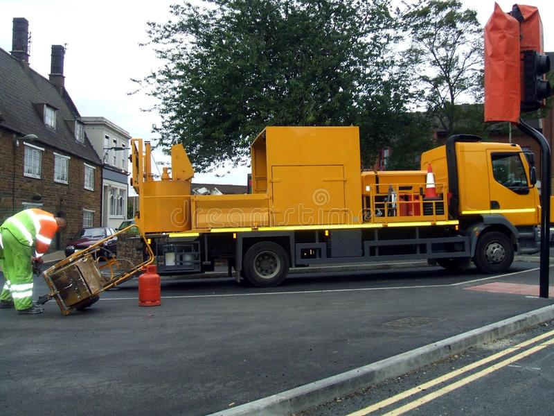 Baustraßenunterhaltungs-LKW oder -fahrzeug lizenzfreies stockbild