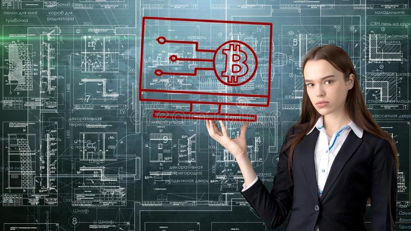 Bauty business woman standing in suit with Bitcoin Logo to illustrate the use of bitcoin for trading or money transfer. stock images