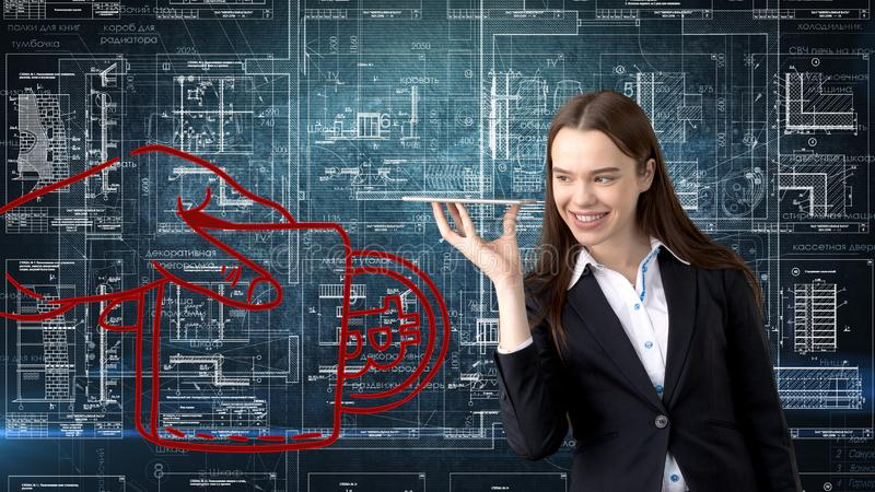 Bauty business woman standing in suit with Bitcoin Logo to illustrate the use of bitcoin for trading or money transfer. stock image