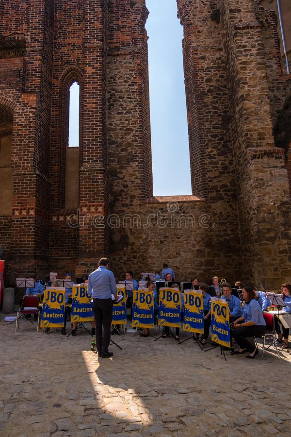 Youth Brass Orchestra Bautzen to the old town festival at the monk ruin stock photo