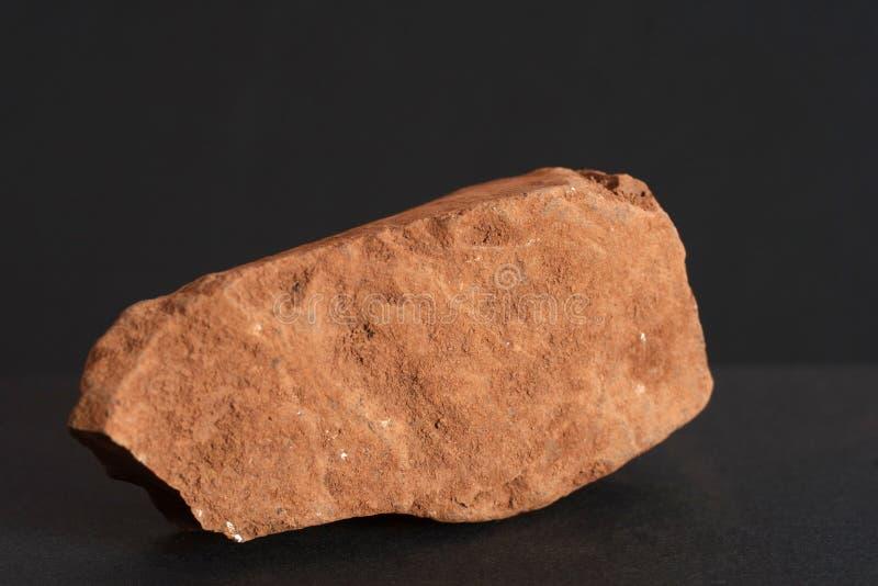 Bauxite mineral also world`s main aluminium ore on black background stock photos
