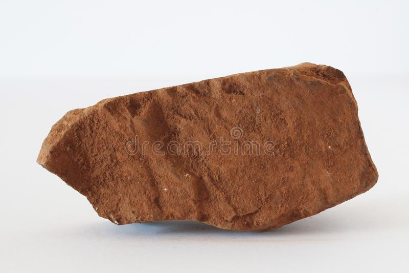 Bauxite mineral also world`s main aluminium ore on white background. Potentially for economic aluminium production markets prices news royalty free stock photos
