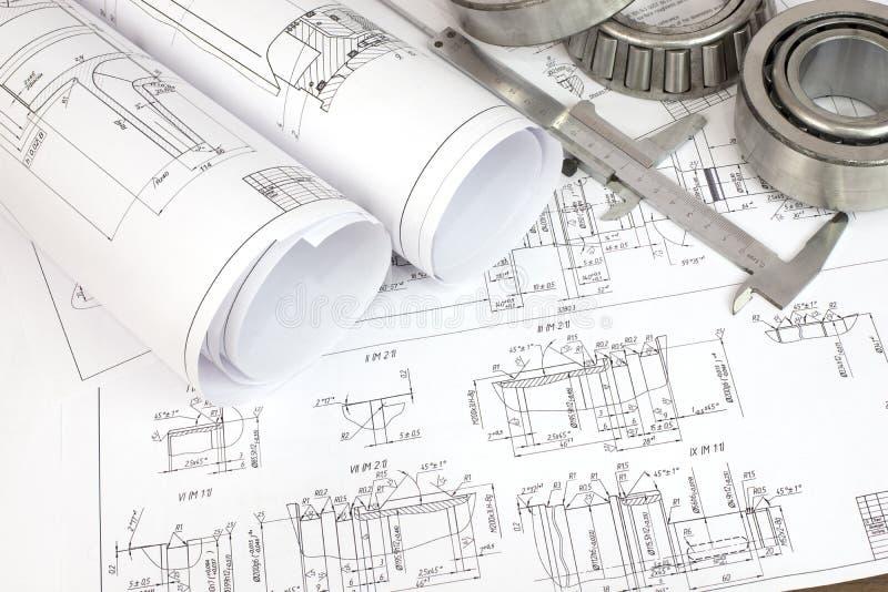 Bauzeichnungen, -tasterzirkel und -lager lizenzfreie stockbilder