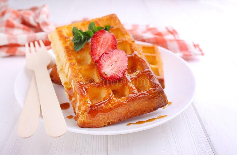 Bavaria with caramel and strawbern waffles servedry stock photo