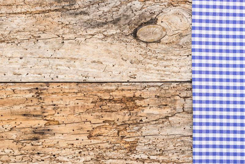 Bavarian background with blue checked fabric border on vintage wood stock photo