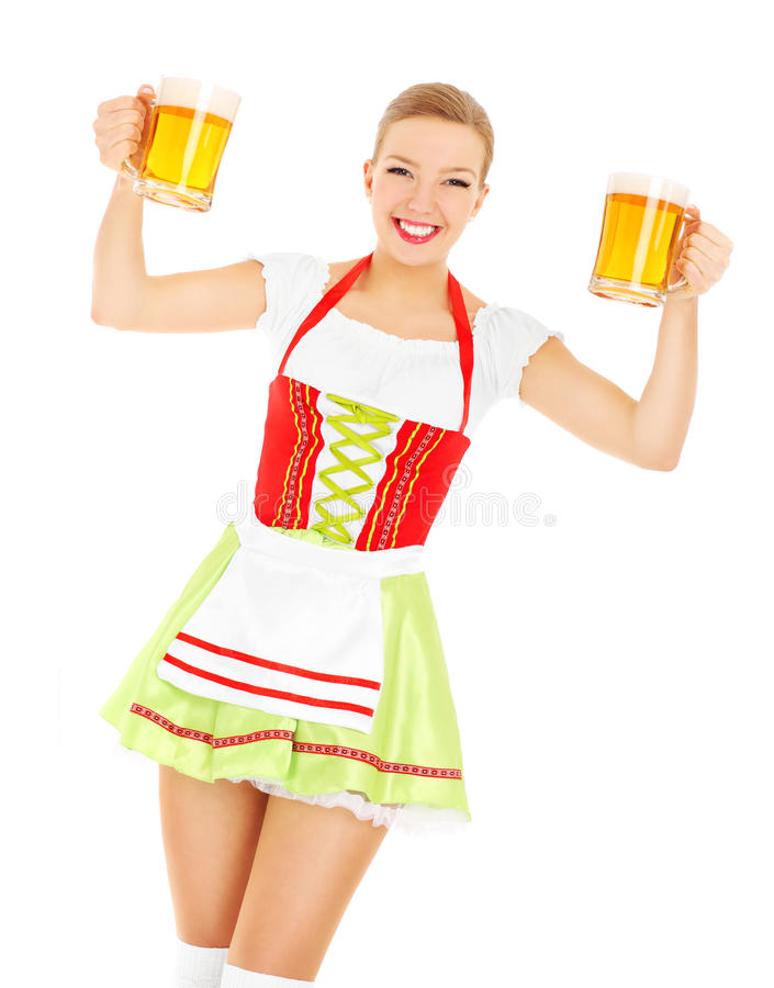 Bavarian beauty. A picture of a beautiful bavarian waitress holding two beer mugs over white background royalty free stock photo