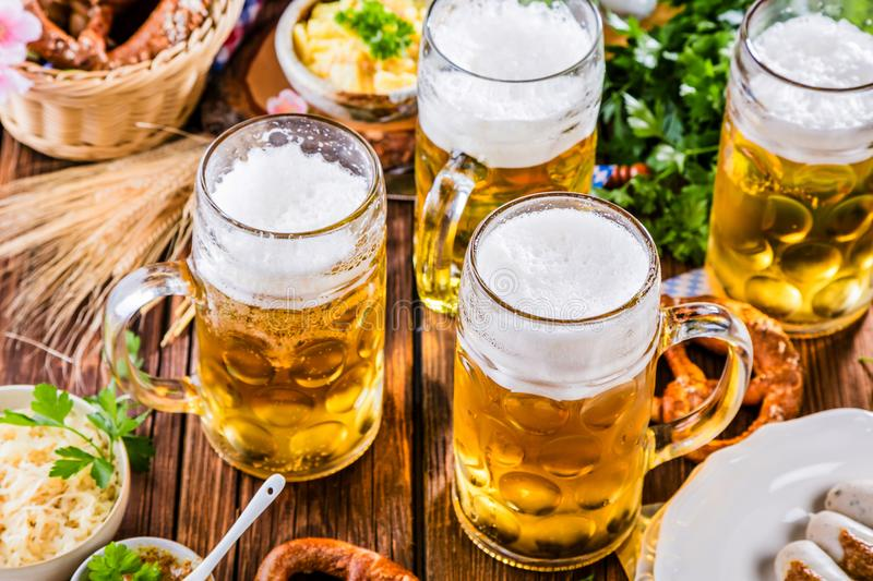 Bavarian beer with soft pretzels royalty free stock images