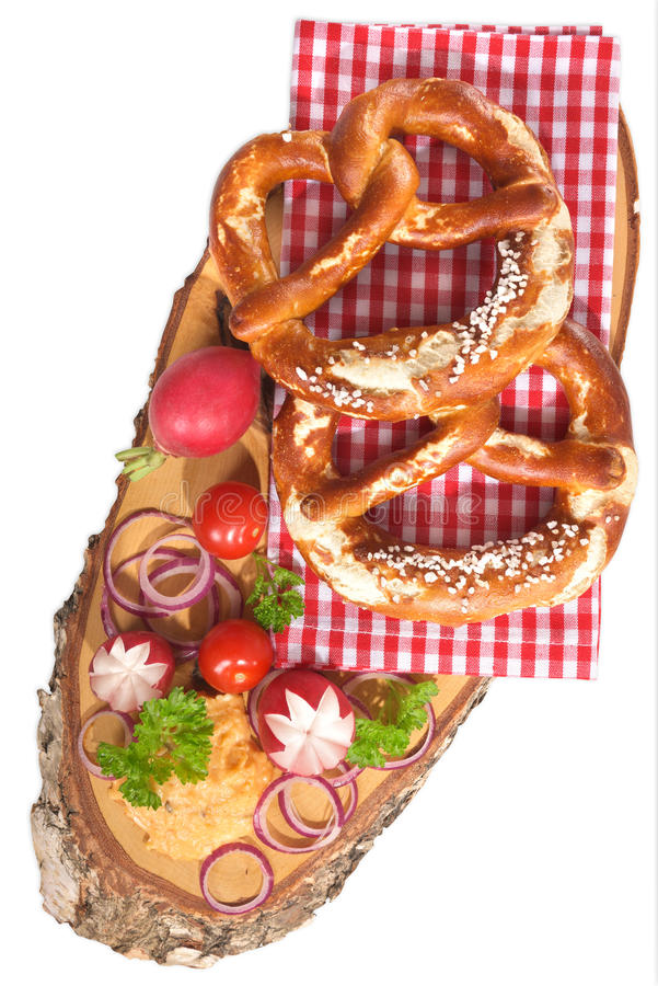 Bavarian breakfast. Bavarian vegetarian breakfast with two soft pretzels and cheese delicacy from Germany isolated on white stock photography