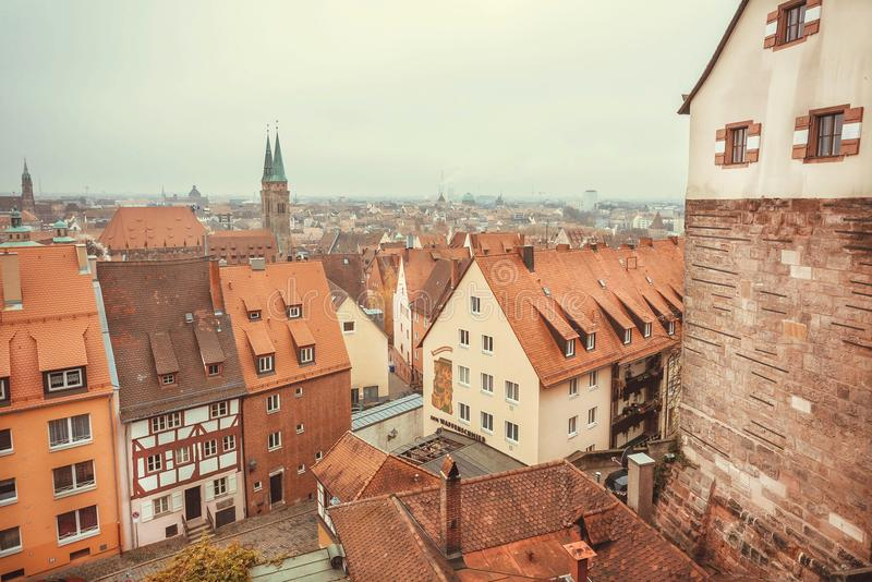Bavarian cityscape with tile roofs, chimneys, towers and old houses on streets stock images