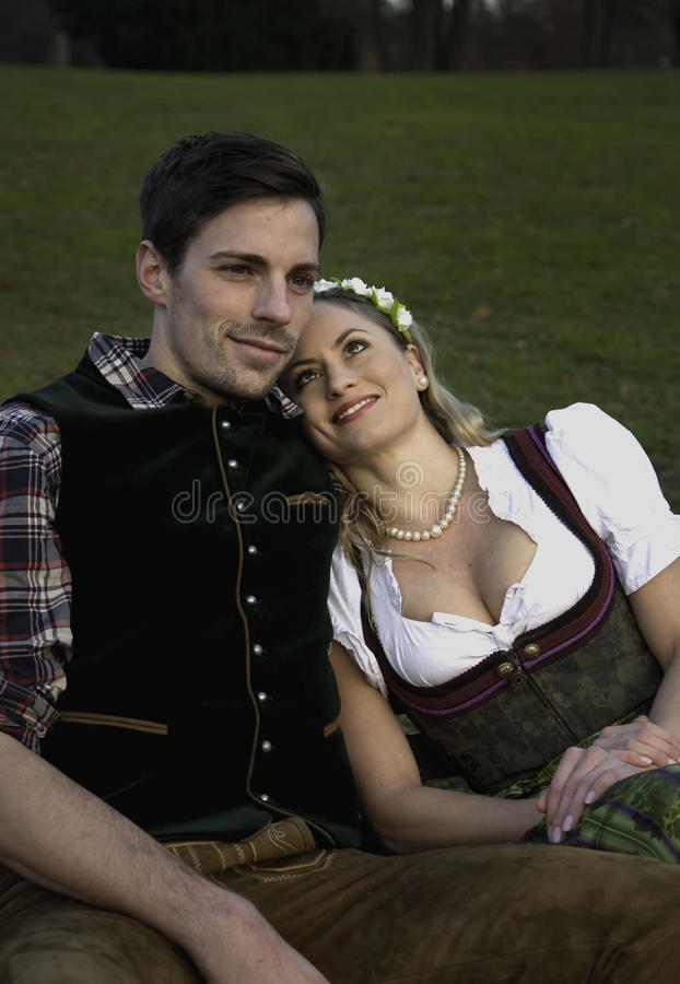 Bavarian Couple in love. Bavarian Couple relaxing on a bench