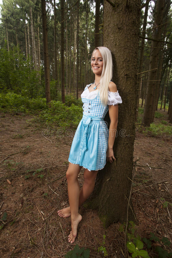 Bavarian dirndl. Blonde woman in a bavarian dirndl stock photography