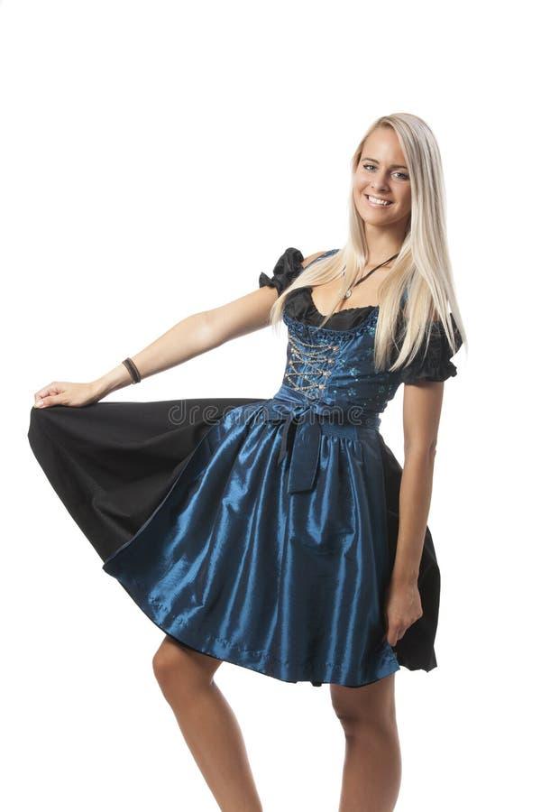 Bavarian dirndl. Blonde woman in a bavarian dirndl stock images