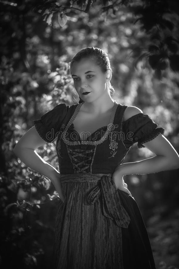 Bavarian girl in costume stock photo