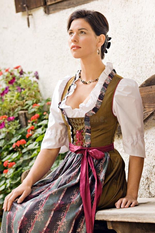 Bavarian Girl at prayer. Bavarian girl in festive attire royalty free stock images