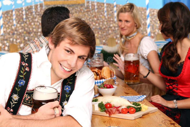 Bavarian group with beer. Bavarian group of man and women having fun in a beer tent stock photos