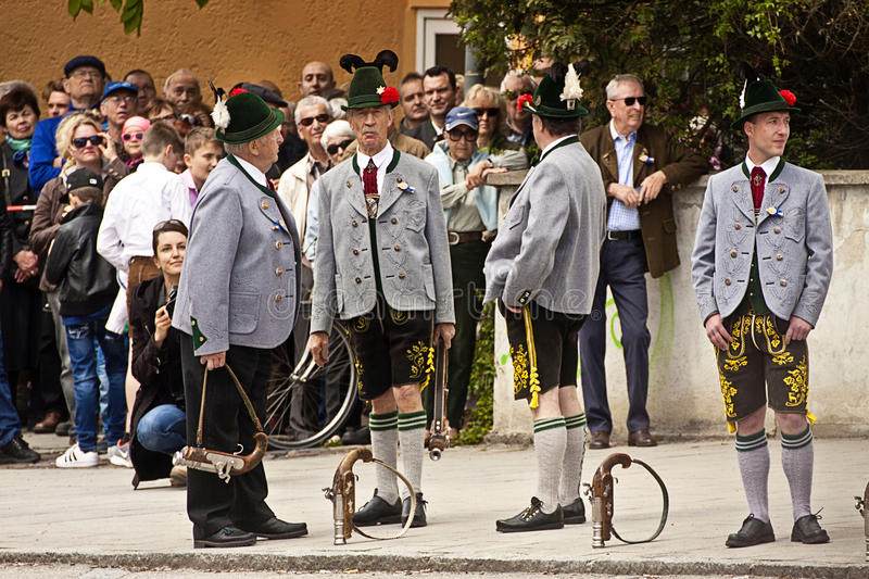 Bavarian huntsmen with traditional costumes. Huntsmen Jaeger with the traditional Bavarian outfit wait with their handguns to salute the arrival and the pose in stock photos