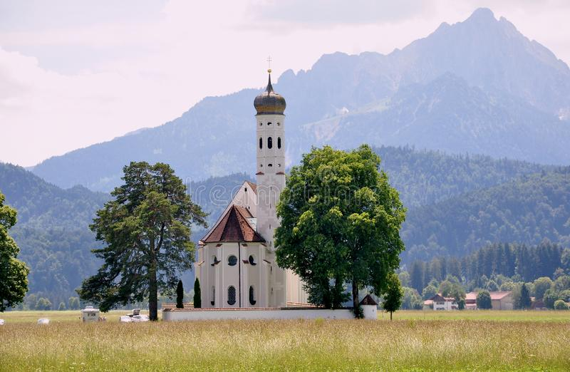 Bavarian landscape, Germany, Munich, autumn time around Oktoberfest. Typical South Bavaria. Small church and the Alps. Peaceful m stock photo