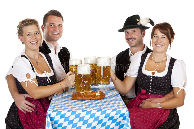 Bavarian men and women with Oktoberfest beer stein royalty free stock image