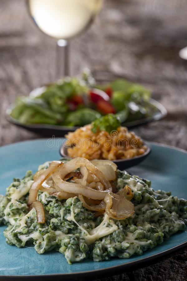 Bavarian pasta with onions. On a plate royalty free stock photography
