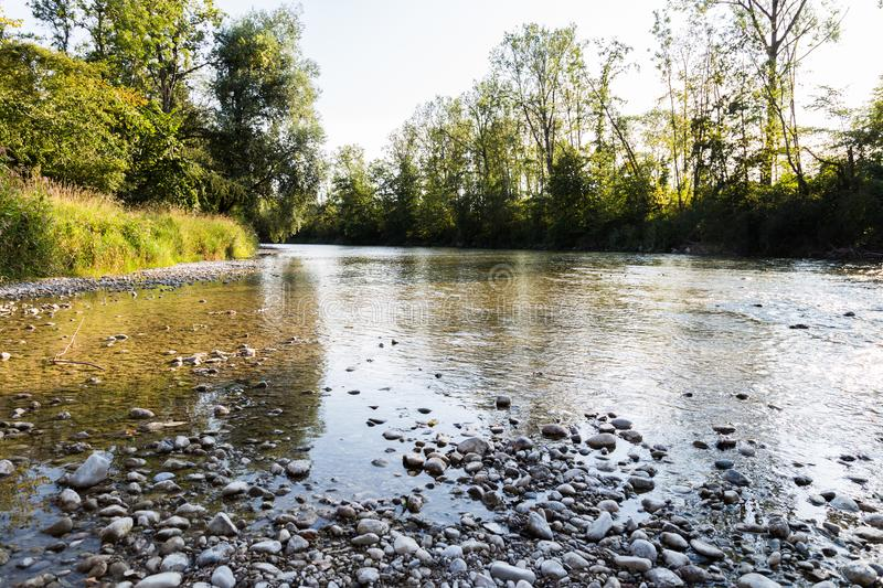 A bavarian river in the sunset. Bavarian river in summer sunset royalty free stock photography