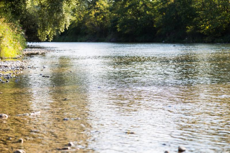 A bavarian river in the sunset. Bavarian river in summer sunset stock photo