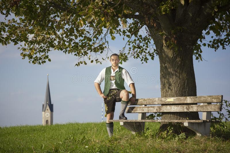Bavarian tradition man in the grass royalty free stock photography