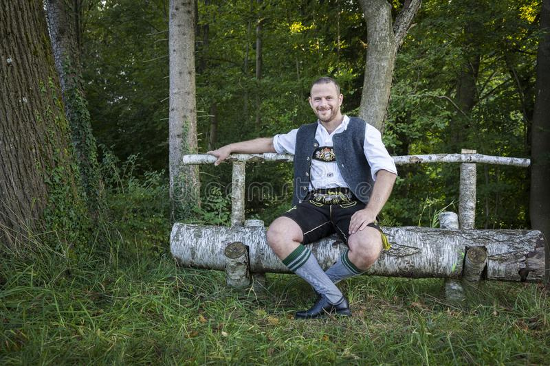 Bavarian tradition man in the grass stock photography