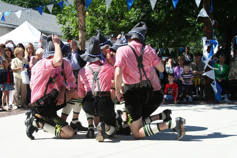 Bavarian Traditional Dancers. German men performing traditional folk dance called Schuhplattler in their Lederhosen outfit at a German-American festival in New royalty free stock images