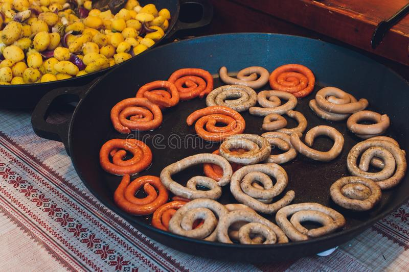 Bavarian veal sausage breakfast with sausages, soft pretzel and mild mustard on wooden board from Germany. royalty free stock photos