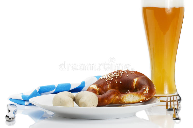 Bavarian veal sausages on a plate with beer, pretz royalty free stock photos