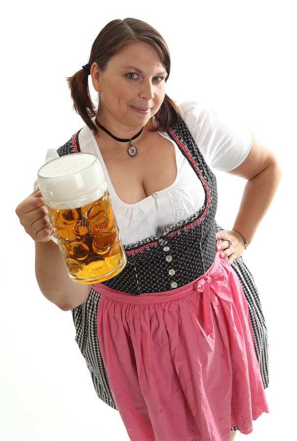 Bavarian Waitress with Octoberfest Beer looking up royalty free stock photo
