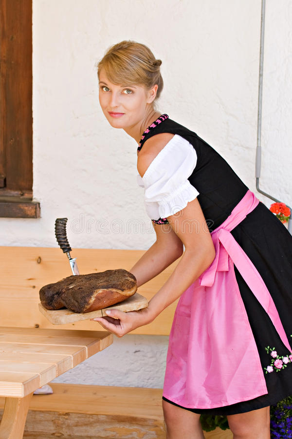 Bavarian woman in a dirndl royalty free stock photography