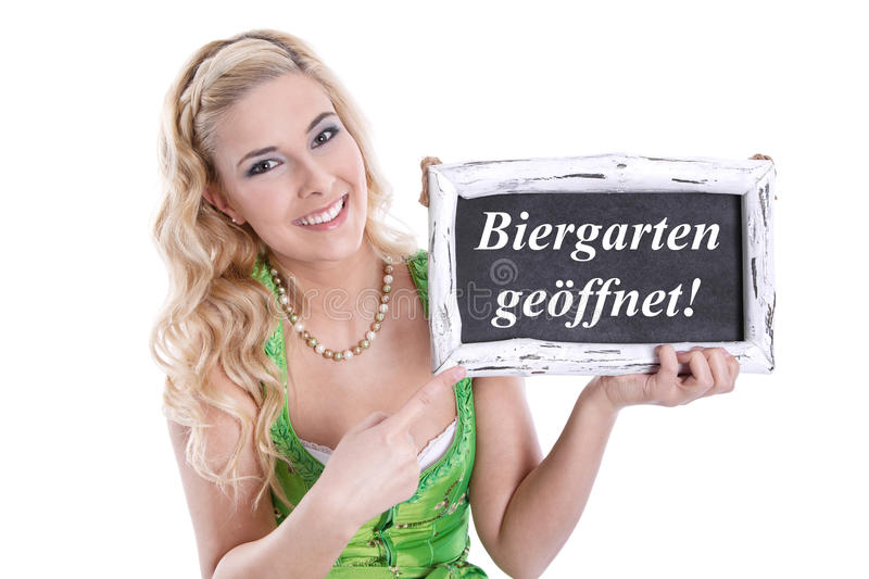 Bavarian woman holding sign stock photography