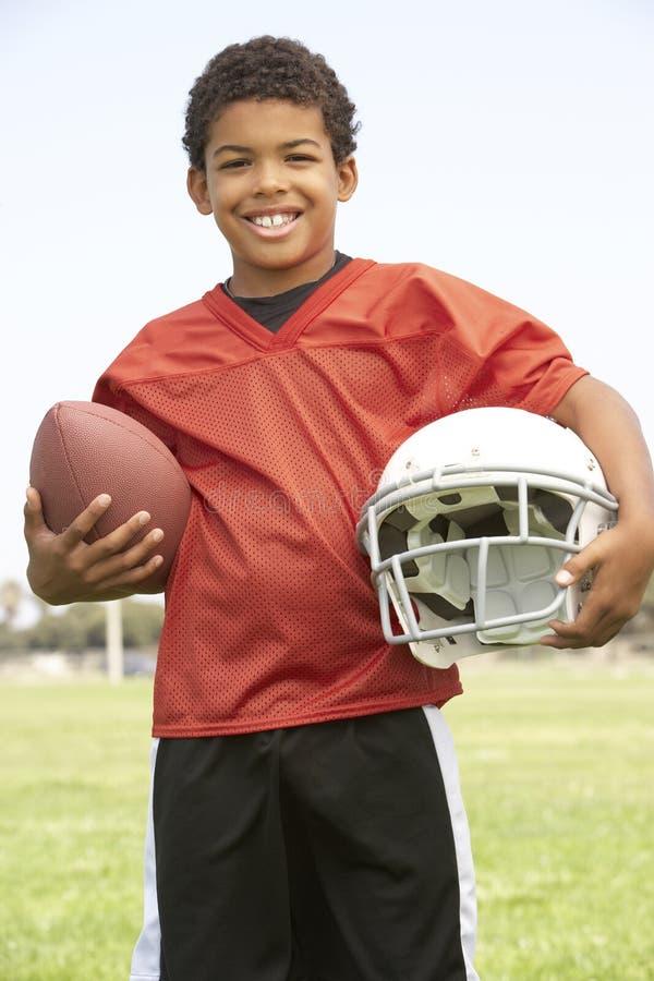 bawić się potomstwa chłopiec amerykański futbol zdjęcie royalty free