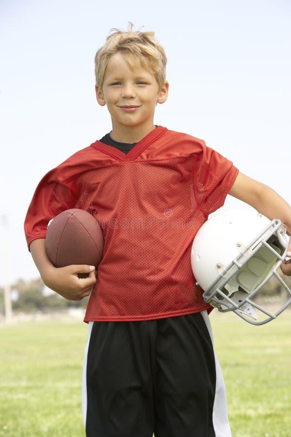 bawić się potomstwa chłopiec amerykański futbol zdjęcia royalty free