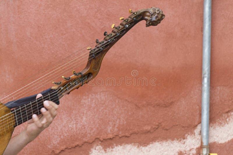 Bawić się starego nawleczonego instrument fotografia royalty free