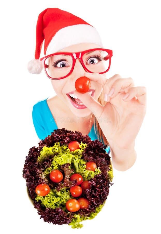 Bawić się z sałatką Santa śmieszna dziewczyna zdjęcia royalty free