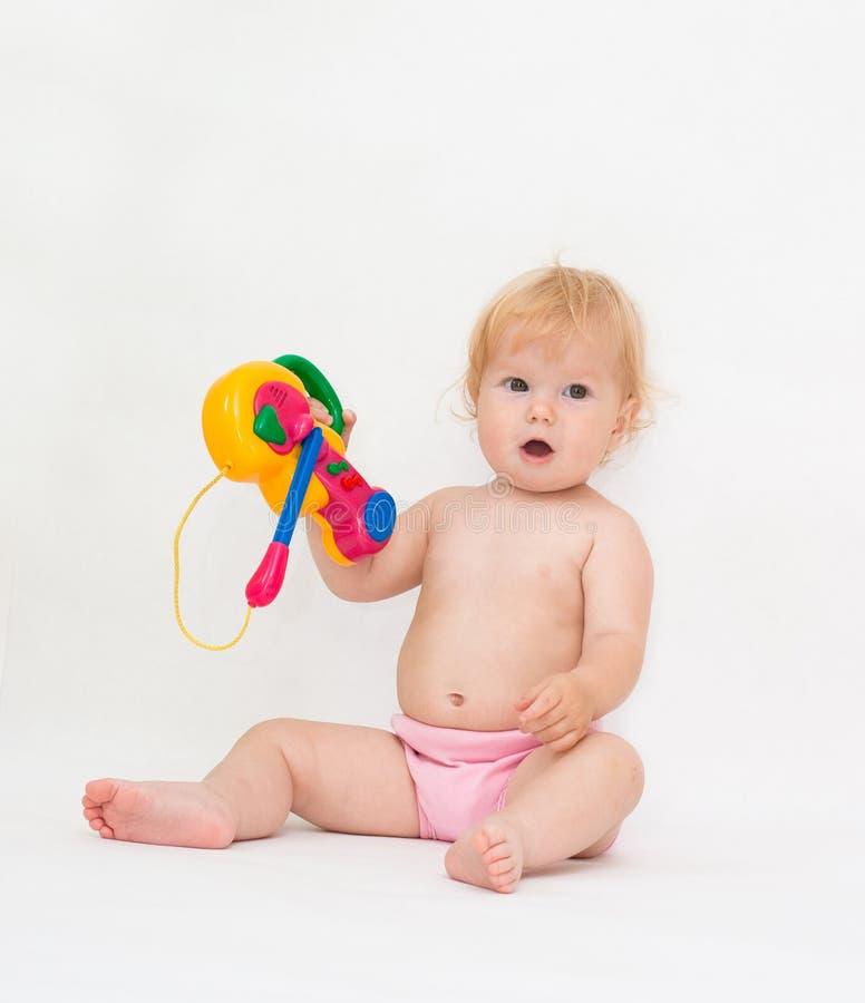 bawić się zabawkę dziewczynki muzyka obraz stock