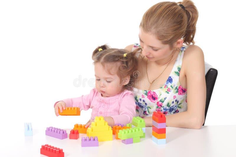 bawić się zabawki córki matka fotografia royalty free