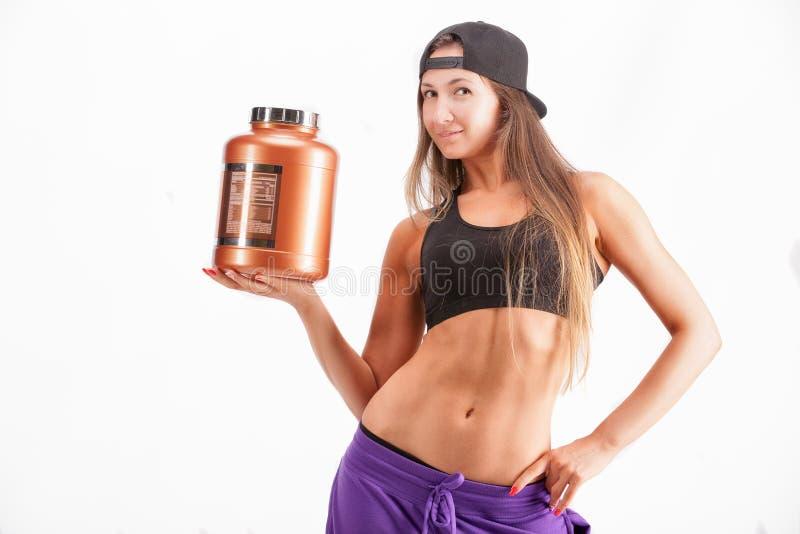 Bawi się dziewczyny z słojem proteina zdjęcie stock