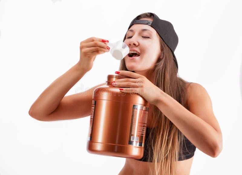 Bawi się dziewczyny z słojem proteina obraz royalty free