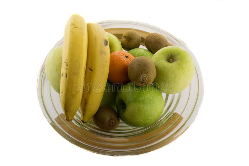 Bawl full of different fruits on the white background royalty free stock image