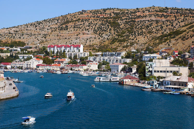 The bay of Balaklava, Sevastopol. Crimea. The Balaklava Bay View. Sailboat and sea taxi. September 2016 royalty free stock photo